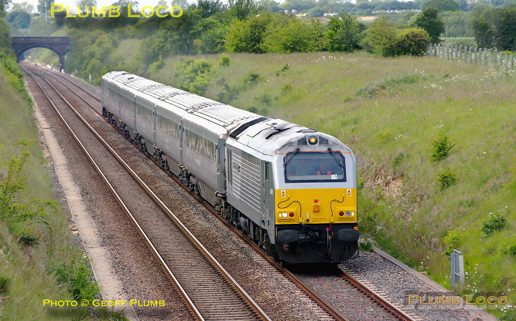 """Soon after 5J67 had passed the same spot northbound, 5H45 appeared working south. This was the 13:58 crew training run from Hatton to Marylebone, 67013 """"Dyfrbont Pontcysyllte"""" leading the five coach set with 82305 on the rear. The train is coming up the gradient from Ardley Tunnel at 14:58, bound for Marylebone. Digital Image No. GMPI9135."""