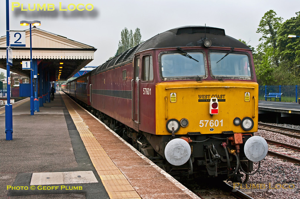 """WCRC 57601 is dead on the rear of 1Z61, 47854 leading the train, as it departs from the stop at Princes Risborough to pick up passengers. This was """"The Golden Arrow Statesman"""", 05:39 from Birmingham New Street to Canterbury West, steam-hauled by 34067 """"Tangmere"""" from Southall. 07:36, Saturday 19th May 2012. Digital Image No. GMPI11802."""