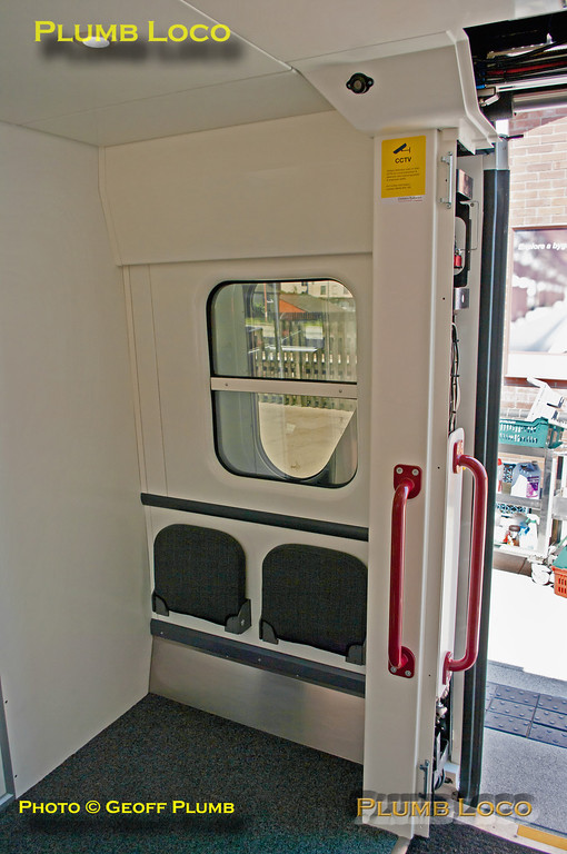 View of the larger vestibule area after removal of the lavatories at one end of TSOL 12605, extra tip-up seats being provided in the area. The panels covering the door mechanism have been removed for demonstration purposes. Birmingham Moor Street, 14:07, Friday 25th May 2012. Digital Image No. GMPI12036.