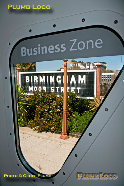 "View through the rather strangely shaped door window of GFW 10271, the ""Business Zone"" coach A in the set. The windows are shaped because the outer skin of the doors is angled towards the body ends and a square window would have required the glass to be angled inwards as well - an added complication! 14:04, Birmingham Moor Street, Friday 25th May 2012. Digital Image No. GMPI12056."