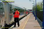 The power doors in the newly refurbished set of Mk.3 coaches are once again put through their paces as test train 5R00 stops at Haddenham & Thame Parkway station, the set now with loco 67014 on the north end, the whole train having been turned. 12:19, Tuesday 22nd May 2012. Digital Image No. GMPI11912.
