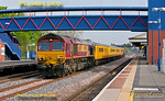 What a difference a day makes! 1Q13 ran as scheduled for a second day on Tuesday 22nd May 2012, this time in lovely warm sunshine. 66019 leads the train through Princes Risborough on the up main line with 66017 on the rear, running a few minutes early at 08:50, en route from Didcot to Marylebone via Banbury and High Wycombe. Digital Image No. GMPI11876.