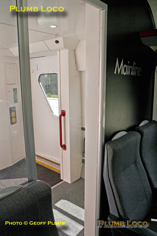The vestibule in TSOL 12605 is now much larger after the lavatory cubicle and luggage racks have been removed and extra tip-up seats added. There does not appear to be a door between the main passenger compartment and the vestibule, though there are doors leading into the Business Zone galley area. 13:54, Friday 25th May 2012. Digital Image No. GMPI12040.