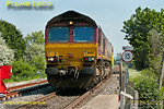 1Q13 continues its travels around the Chiltern lines, 66017 leading again as the train is now en route from Marylebone to Aylesbury Vale Parkway. It has pulled into Aylesbury North Loop to collect the token for the single line section to AVP, and the road is now set for it to continue, seen from the foot-crossing at Griffin Lane. 14:45, Tuesday 22nd May 2012.