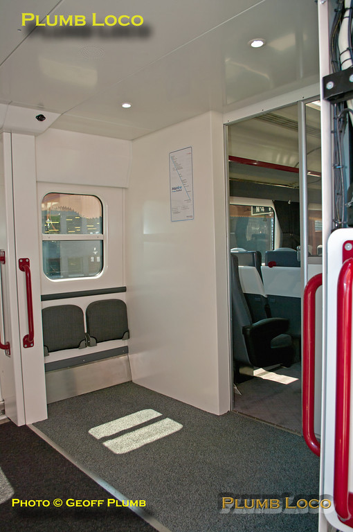 View of the larger vestibule area after removal of the lavatories at one end of TSOL 12605, extra tip-up seats being provided in the area. Birmingham Moor Street, 14:07, Friday 25th May 2012. Digital Image No. GMPI12059.
