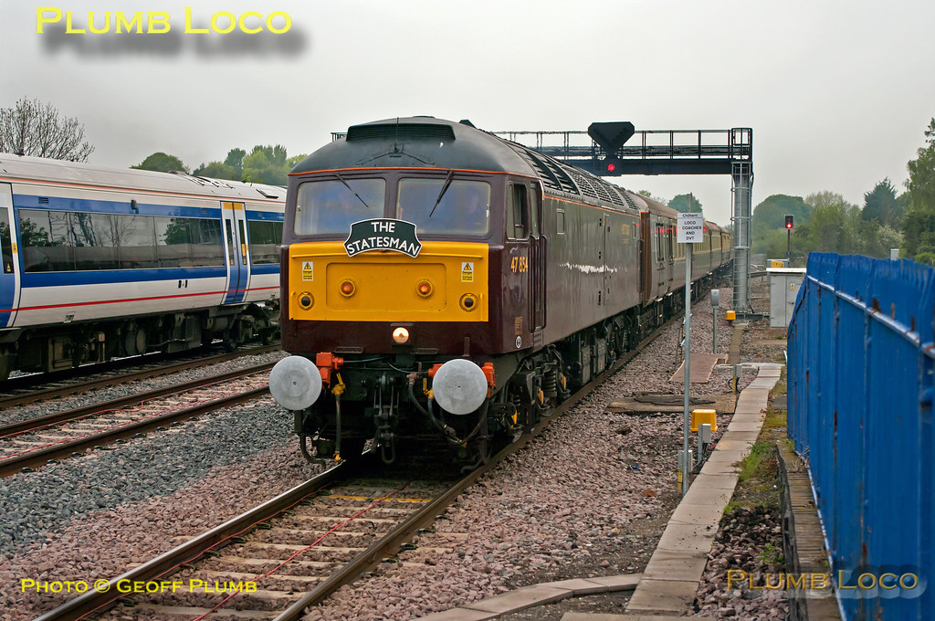 """WCRC 47854 is approaching the station at Princes Risborough, with 57601 dead on rear, for a stop to pick up passengers. It is working 1Z61, """"The Golden Arrow Statesman"""", 05:39 from Birmingham New Street to Canterbury West, steam-hauled by 34067 """"Tangmere"""" from Southall. Due at 07:32 to 07:34, the train was held up a few minutes by a northbound 165 bound for Aylesbury. 172 104 and 168 215 head north from platform 3 with the 07:33 train to Birmingham Snow Hill, 1G10, 07:00 from Marylebone. 07:34, Saturday 19th May 2012. Digital Image No. GMPI11792."""