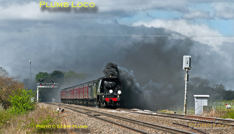 "Unrebuilt ""Battle of Britain"" 4-6-2 No. 34067 ""Tangmere"" attempts to blot out the landscape with a smoky exhaust blown about by a very strong wind as it approaches the foot-crossing just east of Wantage Road with 1Z37, the Gloucester to Worcester leg of ""The Welsh Borders"" tour, originally starting from Bristol. It was running about three minutes early at this point at 11:01 on Saturday 4th May 2013, a day of mixed weather... Digital Image No. GMPI15479."