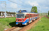 WKD railway emu EN94-23b is seen about to enter W. Aleje Jerozolimskie on a service to Komorow 15/05/2015.