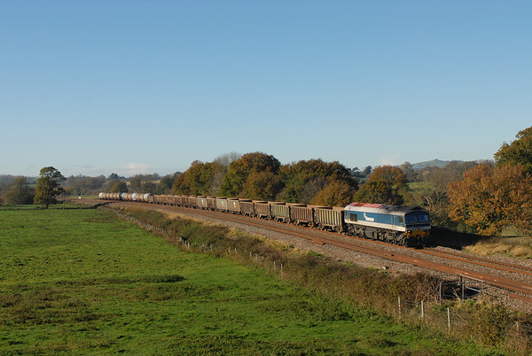 59101 7C28 1158 Exeter Riverside Yard - Whatley Quarry 1551	MT Stone + MT Fuel Tanks via Westbury.  Consist 16 JNA + 13 TTA. passes Silverton