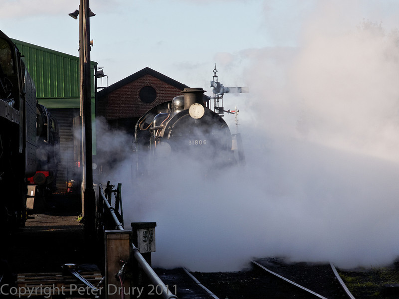 22 Oct 2011 SR U Class No 31806 in the shed yard.<br /> Clearing the cylinders through the drain cocks