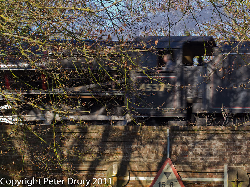 30 January 2011. Alresford - Black 5, 45379.  Copyright Peter Drury 2011<br /> Passing over the road bridge at speed.
