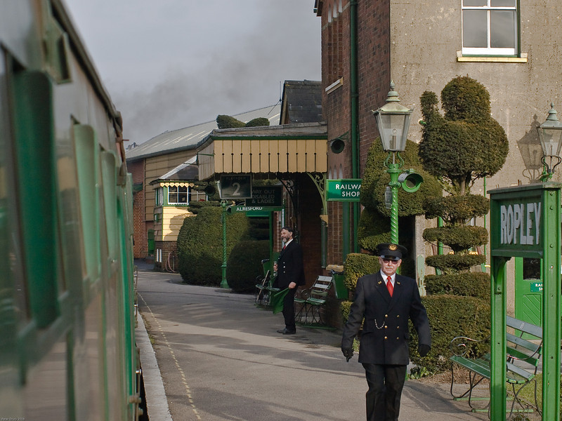 Ropley - Mid Hants Railway. Copyright 2009 Peter Drury<br /> The stationmaster is checking all the doors are closed before giving right-away to the Alresford bound train.