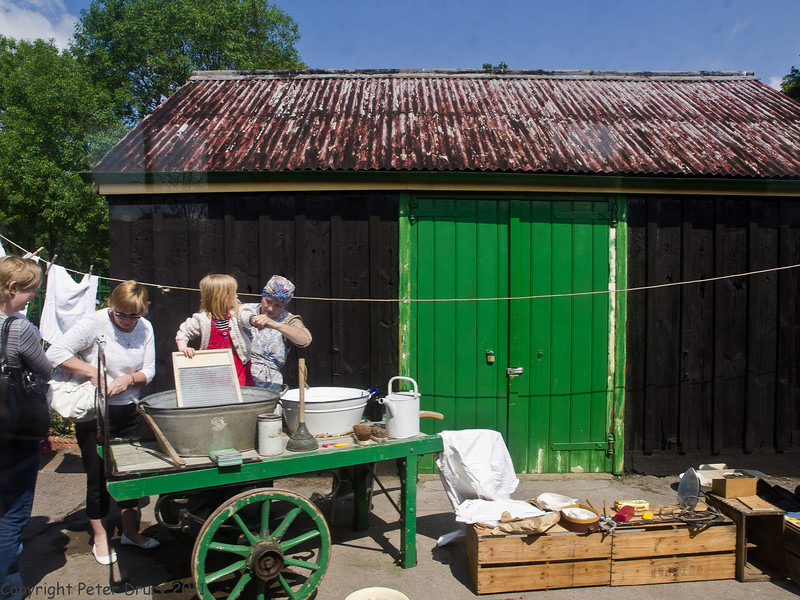 11 Jun 2011. War on the Line. The Up platform had a WW2 washday demonstration. All the washing done by hand and scrubbed with a corrugated board in the metal bath. Copyright Peter Drury 2011