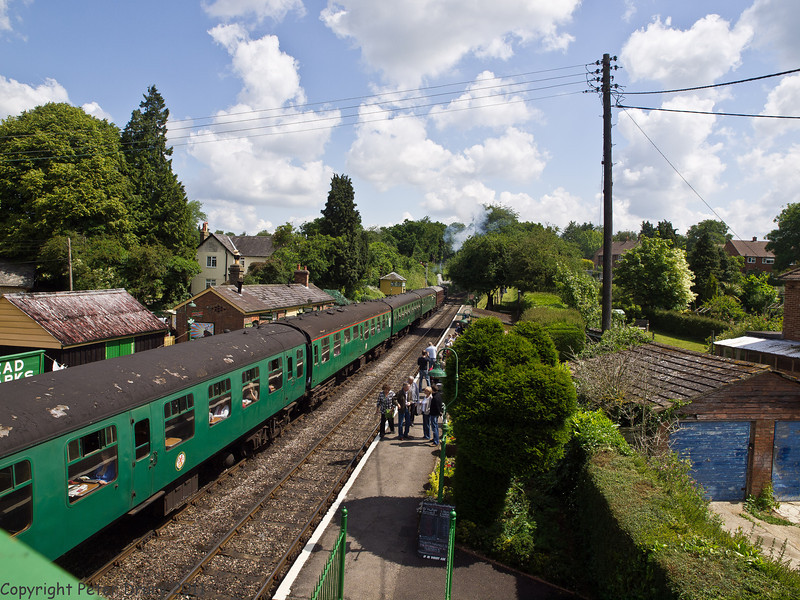 11 Jun 2011. Alton bound train departing from Meadstead & Four Marks up platform with Black 5 45379 at its head. Copyright Peter Drury 2011