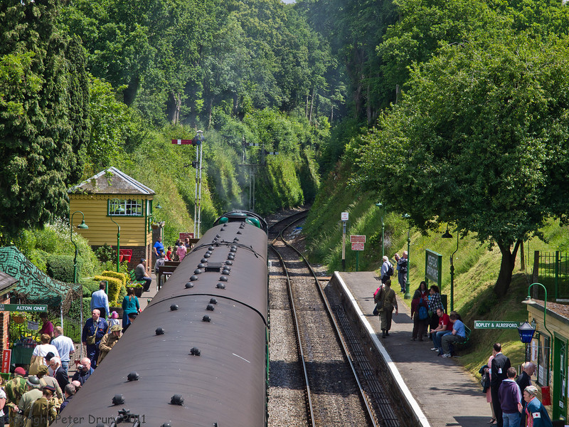 11 Jun 2011. War on the Line. Alton bound train awaiting departure from Meadstead & Four Marks up platform with 850 Lord Nelson at its head. Copyright Peter Drury 2011