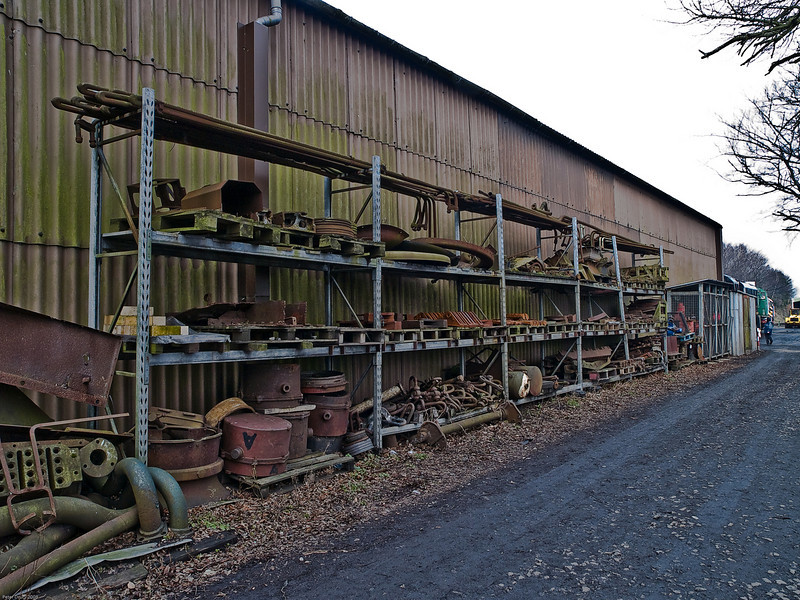 Ropley - Mid Hants Railway. Copyright 2009 Peter Drury<br /> Some of the spares to keep the locomotives running and some large parts removed from locos in work are stored on the racks outside the shed.