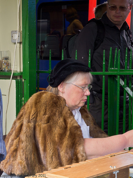 11 Jun 2011. War on the Line. The temporary ticket office at Alton Station with the clerk, in period dress, at her desk. Copyright Peter Drury 2011