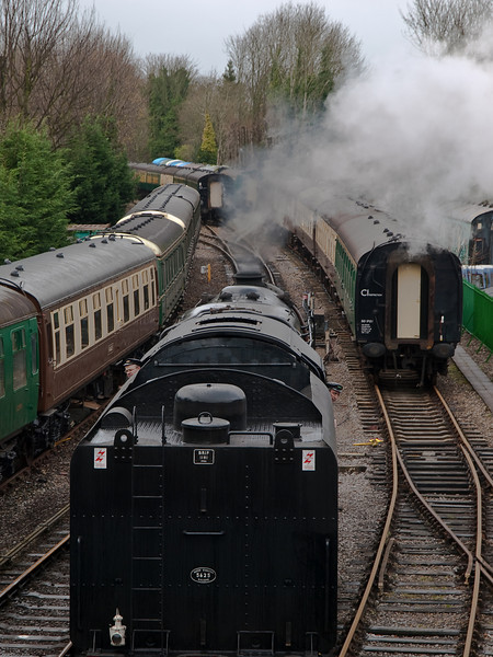92212 BR Standard 9F running round train at Alresford. Copyright 2009 Peter Drury<br /> The loco has now almost reached the footbridge. Both the driver and fireman are watching as the loco reverses.