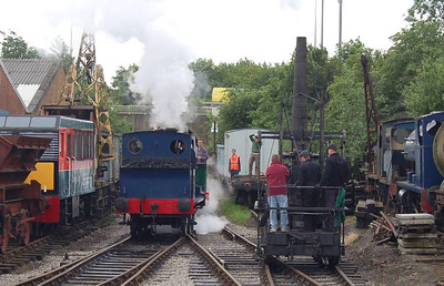 The Manning Wardles setting back onto the main line train as the Steam Elephant passes.