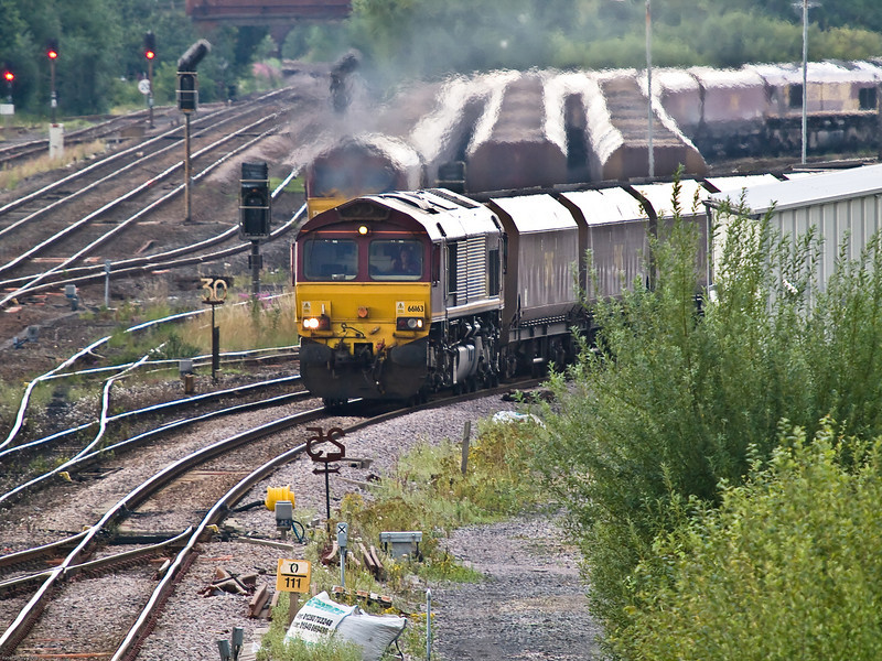 Loaded Coal Train from Gascoigne Wood.<br /> 66163 approaches the junction with a train on the Selby line. Three of the loop sidings behind the train with another loaded train awaiting departure on the left and 2 empty rakes to the right. Each rake has a class 66 locomotive attached.