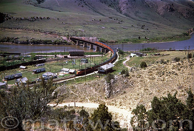 Milwaukee Road E20 Eastbound Crossing the Missouri River, Northern Pacific Mainline, and the Small Town of Lombard as it enters Sixteen Mile Canyon.  May 27, 1953  Photographer Unknown