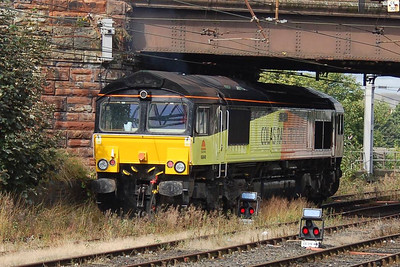 Colas Rail 66849 hiding in the undergrowth at the north end of Carlisle Station on 20th August 2012