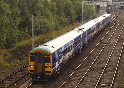 158910 leading a four-coach train from Leeds at London Road Junction in Carlisle on 18th August 2012.