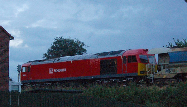A very grainy shot of  60015 in the late evening of 16th August 2012 as it headed an engineering train up the Tyne Valley