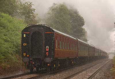 48151 heads away from the camera, with rainwater pouring off the ends of the gutters on the coaching stock.
