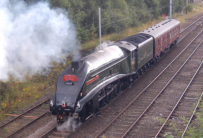 "A bit of a bonus. Having decided not to go out filming the steam hauled railtour to Carlisle on 18th August as we were expecting 46233 ""Duchess of Sutherland"" it was pleasing to be told that the motive power was actually 60009 ""Union of South Africa"". Here the loco is seen propelling the support coach from London Road Junction towards Petteril Bridge Junction."