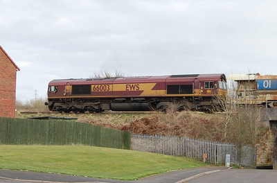 A phone call from my other half alerted me to the imminent passing of a Matisa P95 High Output Track Relaying Train along the Tyne Valley line. After a punishing walk of about 50 yards I got this shot of 66003 at the head of the train.