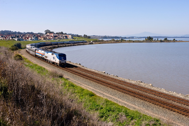 It is Friday, March 9, 2012 and the last eastbound Reno Fun Train has left Amtrak's Emeryville depot 15 minutes late and rounds the curve at Hercules.