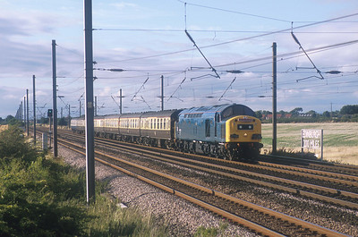 40145 speeds past Shipton just north of York with the 'Whistling Scotsman' weekend special returning from Inverness. 28/8/05
