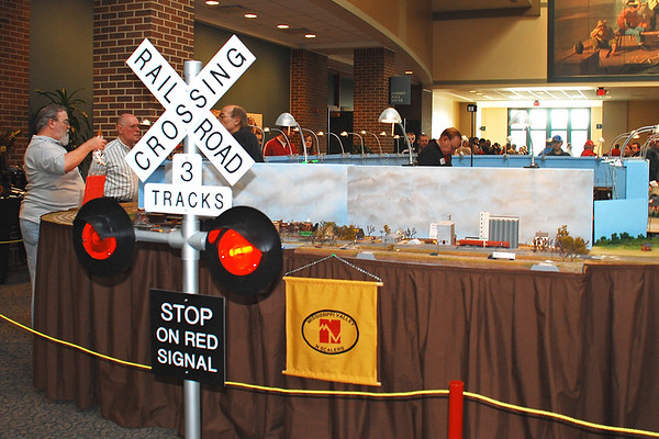 Custom-made railroad crossing sign attracts visitors to our layout.