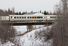 Passenger coaches in the consist of the regular mixed train (Little Bear) crossing Store Creek in Moosonee 2007 April 14th. Baggage 412, coach 603.