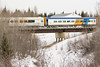 Passenger coaches in the consist of the regular mixed train (Little Bear) crossing Store Creek in Moosonee 2007 April 14th. Coach 851 and coach 603.