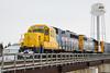 GP40-2 2201 and GP38-2 1800 at the head of the regular mixed train (Little Bear) in Moosonee 2007 April 14th crossing bridge over Store Creek.