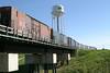 "Freight cars in consist of the mixed train (""Little Bear"") crossing Store Creek in Moosonee 2004 June 12"
