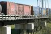 "Freight cars in consist of the mixed train (""Little Bear"") crossing Store Creek in Moosonee 2004 June 12."