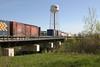 """Mixed train (""""Little Bear"""") crossing Store Creek in Moosonee on its way south 2004 June 12. Canoe car 4507"""