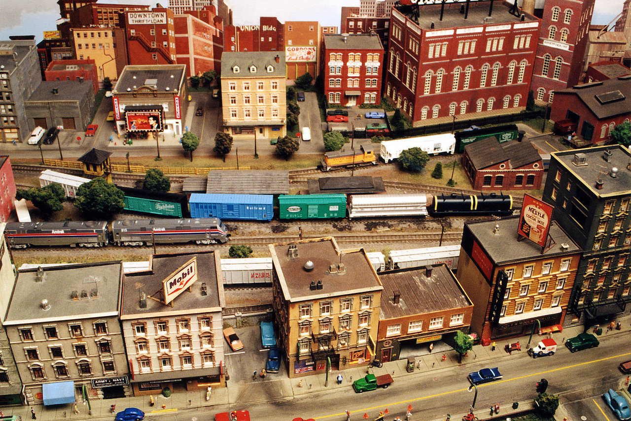 Here's my N Scale city module.  The city features neon-like signs in the shop windows, working headlights, working roof fans, and computer controlled / properly cycling stop lights!