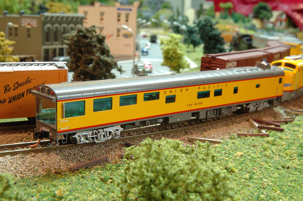 The Fox River is one of my prettiest N Scale passenger cars.  In real life, it served as a track inspection car.  The real Fox River car was built in 1954 by Pullman Standard as a two-bedroom, two-compartment, buffet-lounge-sleeper for Canadian National Railway. Later in life it was converted to a inspection car with terraced theatre seating facing the huge full-width picture window.  in 1985 the Chicago and North Western bought the car and gave it the number 420 and the name Fox River.  After Union Pacific and C&NW merged a decade later,  Fox River was taken to Northern Railcar for renovation.  Today it is equipped with a galley for the preparation of buffet-style meals and has a beautiful wood interior.