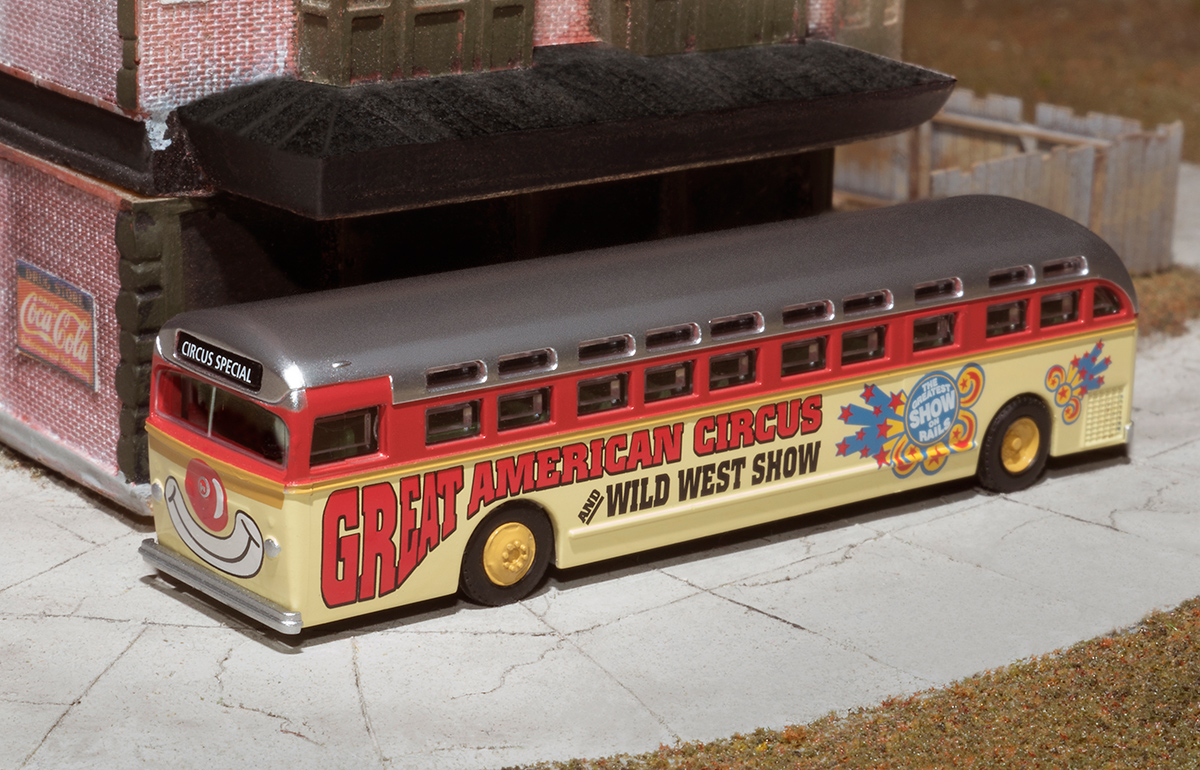 """""""Clown Bus"""" - part of the Great American Circus series by Lowell Smith http://lowellsmith.net/product-category/n-scale/great-american-circus/.  The bus body is made by Wheels of Time and is beautifully detailed including removable rubber wheels.  This amount of detail in N scale is truly award worthy.  This same body style was produced by Wheels of Time as a Greyhound bus and other historically accurate motor coaches http://www.wheelsotime.com/transit-coach/."""