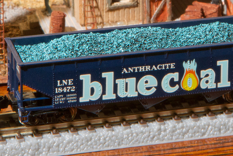 "A close-up view of the ""Blue Coal"".  I've never seen blue coal ""in the wild"" but I've read that it was about the color of billiard cue chalk - which this certainly is.  Blue coal was ""anthracite"" - a clean-burning coal mined in Pennsylvania and well-suited for home heating back in the day.  The coal was often sprayed while it is being crushed and processed.  The purpose was to cut down on dust and to help the coal flow evenly.  In the late 1920's one company started using blue color in the spray as a marketing gimmick.  It must have been effective because soon other companies offered other colors.  Incidentally, if you have heard of blue coal already then you may be old enough to remember the radio serial ""The Shadow"" sponsored by... Blue Coal."