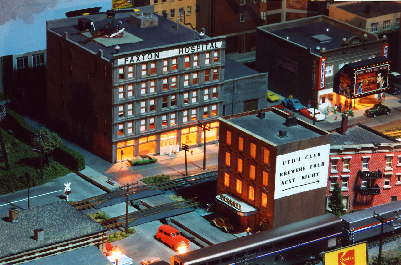 This is the far end of the N Scale city module.  The buildings are lit, the theatre marquee has chaser lights, and street lights and stop lights work and are properly synchronized. There are dozens of tiny details on this module which make it a real crowd pleaser when I bring it to a model train show.  Unfortunately, it is difficult to transport and set-up because it's actually one of three contiguous modules totaling 12 feet and containing multiple tracks.