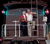 Dave and Micke Trussell on the platform of the C&S caboose in the Greeley Freight Station Museum shortly before Christmas, 2004.