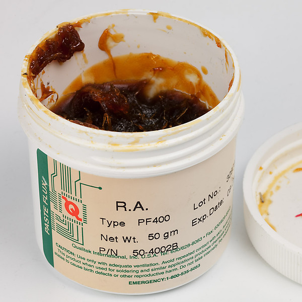 For normal electronic soldering, a rosin-based flux should be used. This jar of electronic soldering rosin paste has been in use for almost a decade. Few of us will empty the jar before it expires and becomes thicker. When that happens, a few drops of ordinary IPA added to the jar will restore it to normal viscosity. (IPA = isopropyl alcohol, or rubbing alcohol.)