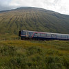 4th September 2010. Class 156 unit 156456 skirts the foot of Ben Dorain on the approach to Bridge of Orchy Station.