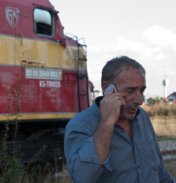 The supervisor trying to sort out what was happening with the train from the Macedonian border (it still ran to the border even though Macedonian railways were not operating the service beyond the border). We had planned to take this train back from Fushe Kosovo to Pristina main station but got the bus back into town instead rather than wait to see if it showed up. After our few days in Pristina we also decided to take the coach back to Skopje rather than take the train to the border and take our chances. Though we met some Brits who had done that later and said it worked out ok (though it was a unit rather than a loco hauled working)