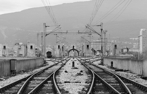 Not my picture of Skopje railway station - which was part of a wider modernist Yugo rebuild of the city (to a masterplan by Japanese architect Kenzo Tange) which had been mostly destroyed in a 1963 earthquake. The railway dissects the city in as straight line passing through the less is more canopies of the central station. Which is now run down and moribund in contrast to the busy and efficient coach station right next door.